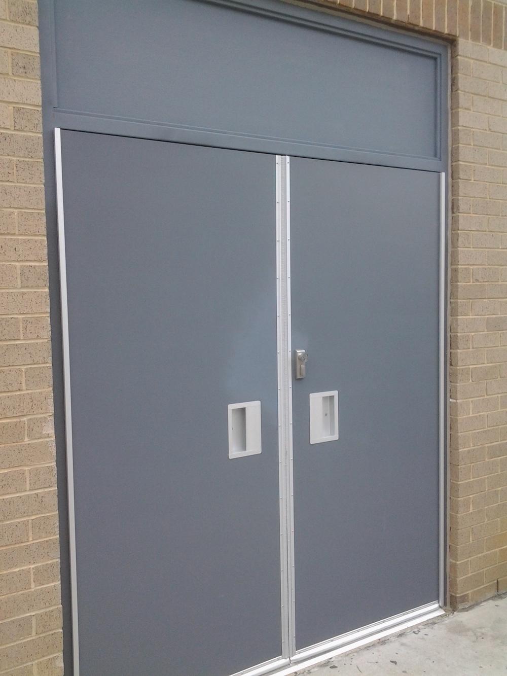 Flush pull hollow metal doors national security door for Flush exterior door